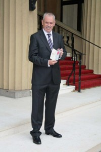 John Martin with his MBE